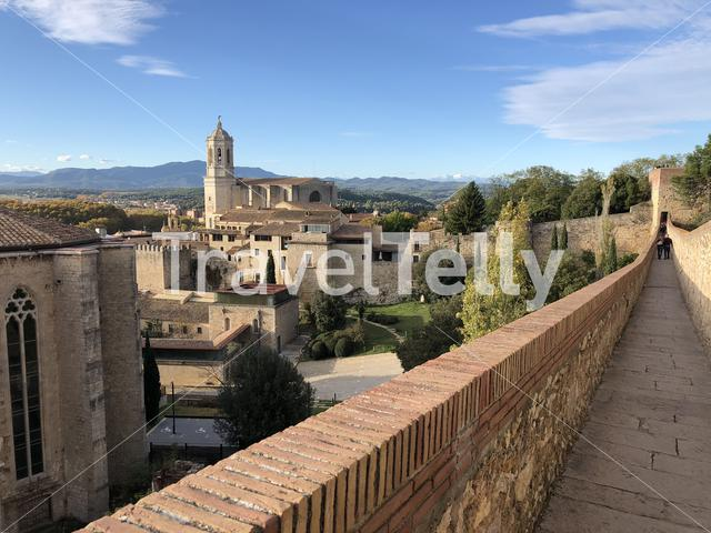 Tourists walking at the city wall of Girona in Spain