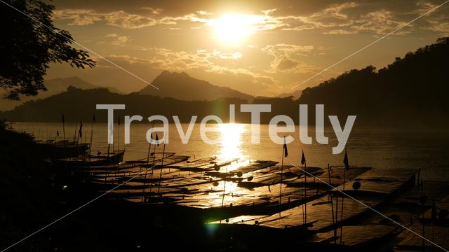 Sunset with Long-tail boats at the Mekong River in Luang Prabang, Laos