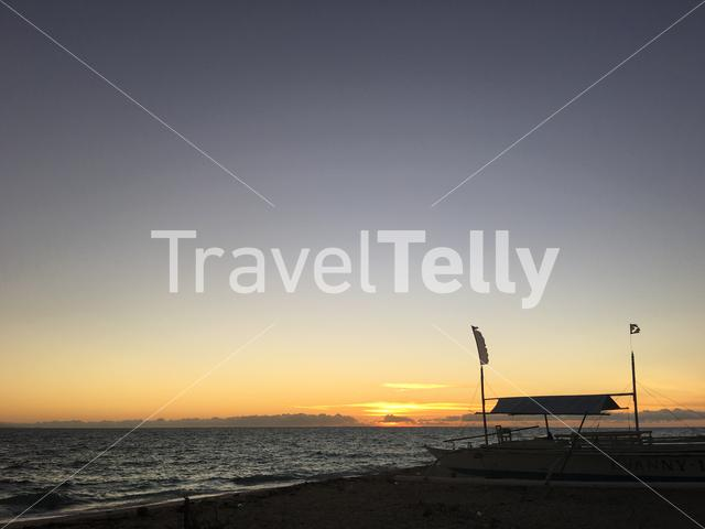 Sunrise and catamaran boat at the beach of Balicasag Island in Bohol the Philippines