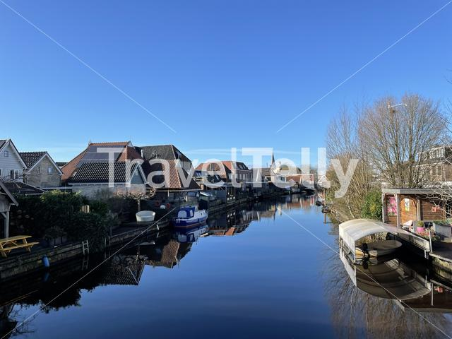 Canal in Akkrum on a winter day in Friesland The Netherlands