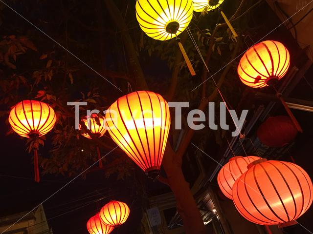 Red and orange lanterns at night in the street of Hoi An Vietnam