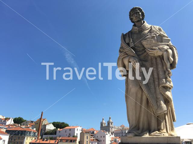 Lisbon city view with a statue at Portas do Sol in Portugal