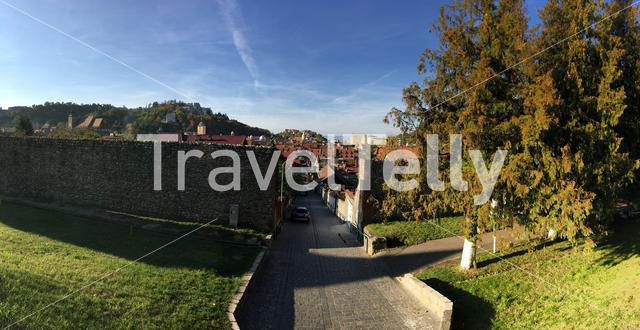 Panorama from the medieval wall and entrance towards the old town of Brasov Romania