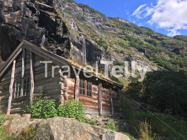 A wooden Norwegian mountain hut in against a mountain backdrop in Aurlandsdalen, Norway. Taken during a hike between Østerbø and Vassbygdi.