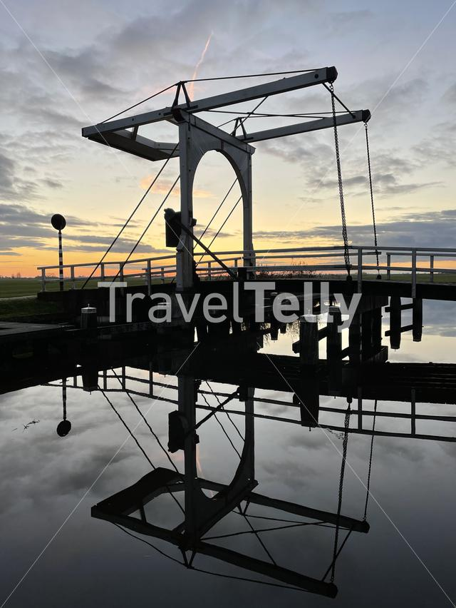 Bridge reflection in IJlst during sunset in Friesland The Netherlands