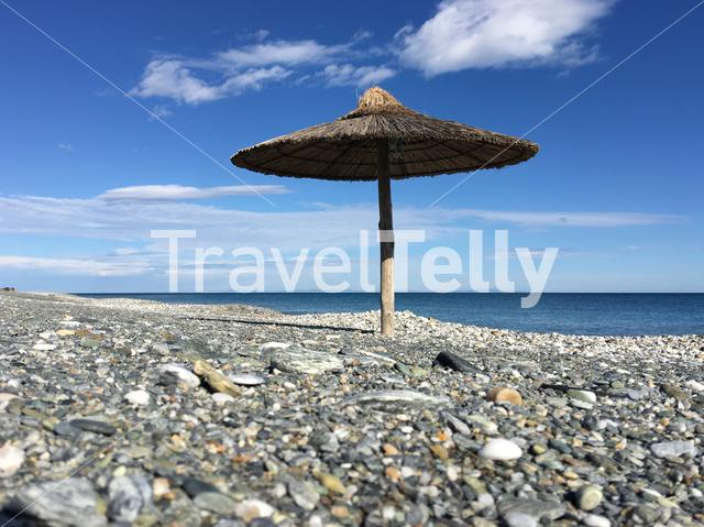 Velika beach with a parasol in Greece