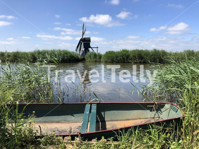 Windmill and a boat in Friesland The Netherlands