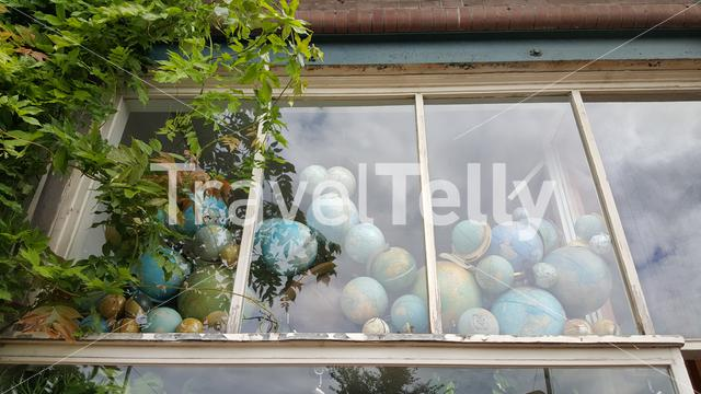 Lots of globes behind glass window