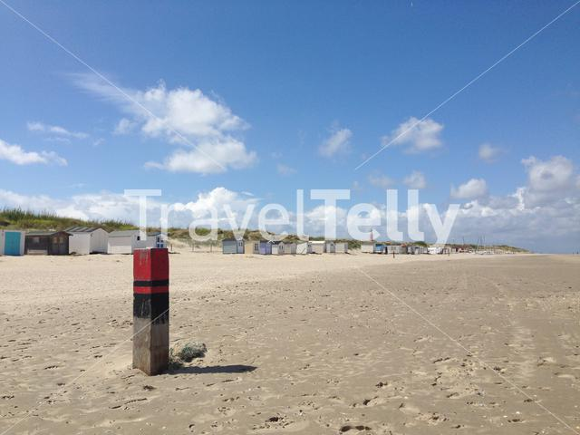 Beach pole and houses in Texel The Netherlands