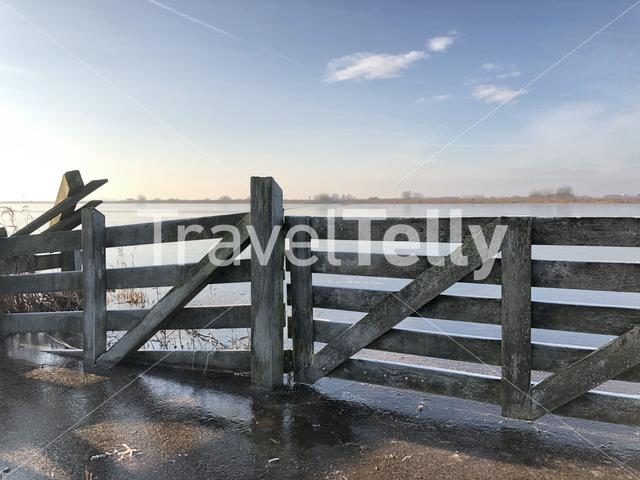 Fence with ice in Sneek, Friesland The Netherlands