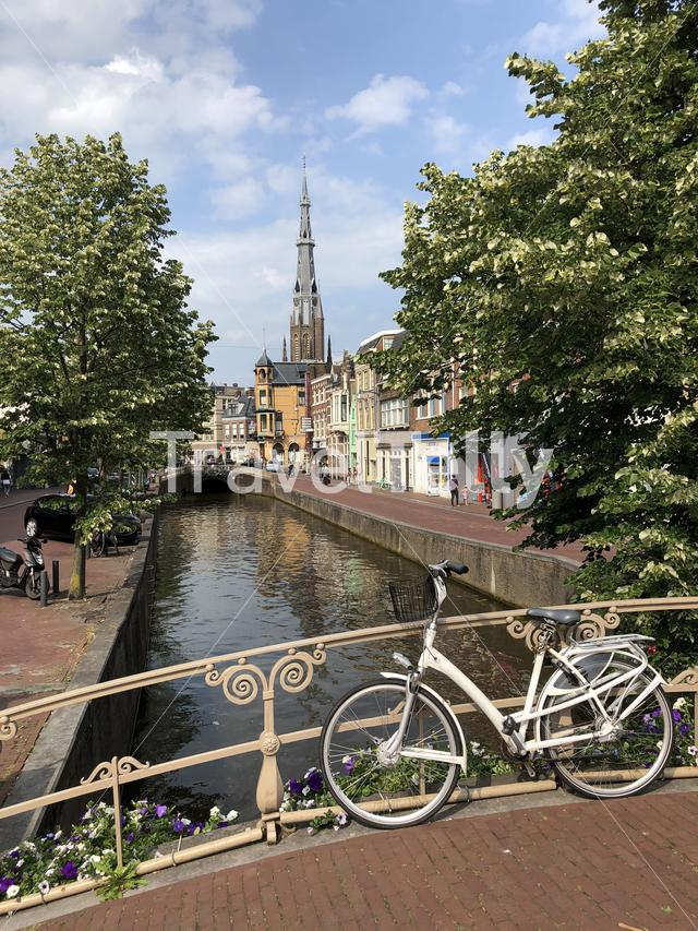 Bicycle on a canal bridge with the Sint-Bonifatiuskerk church in the background in Leeuwarden, Friesland The Netherlands