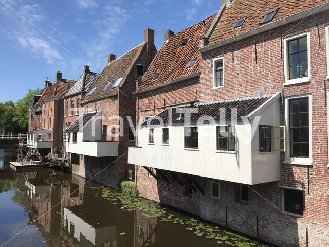 Canal with hanging kitchens in Appingedam Groningen The Netherlands