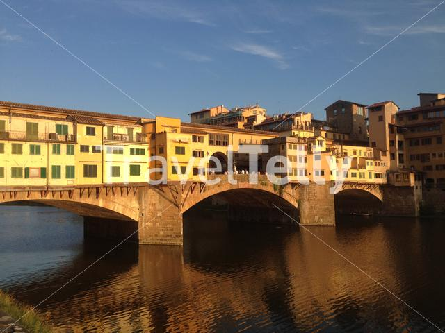 Sunset light shining on the Ponte Vecchio in Florence Italy
