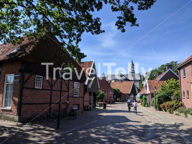 Tourist cycling in the old town of Ootmarsum, The Netherlands