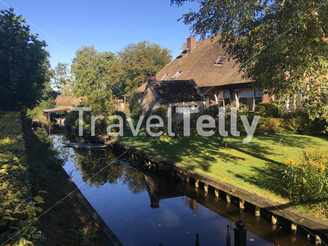 Small canal next to a house in Giethoorn The Netherlands