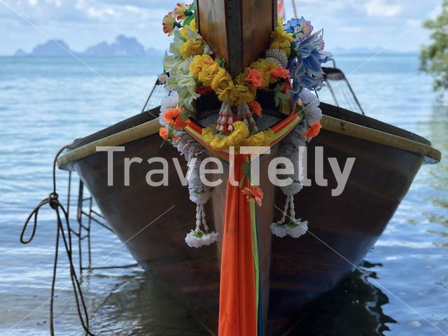 Colorful clothes tied to the bow of long-tail boat in Koh Mook Thailand