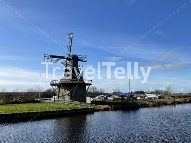 Windmill next to a canal in Joure Friesland The Netherlands