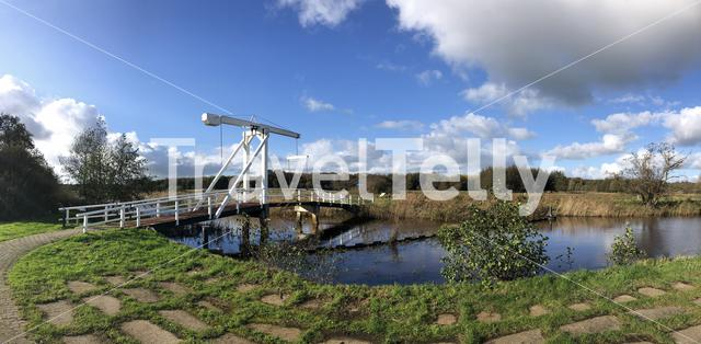 Panorama from a bridge over a canal around Nijeholtpade in Friesland, The Netherlands