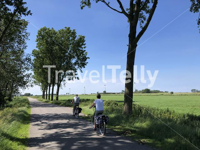 Couple cycling in Friesland, The Netherlands