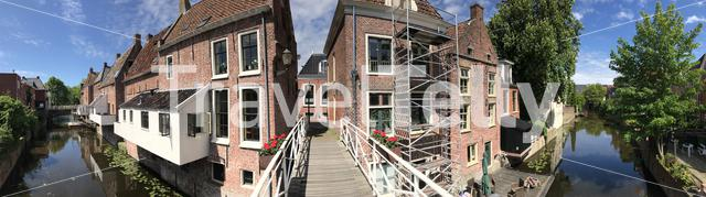 Panorama from a bridge and hanging kitchens in Appingedam The Netherlands