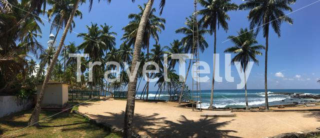 Panorama from Dondra Head Lighthouse behind palmtrees near the southern most point in Sri Lanka
