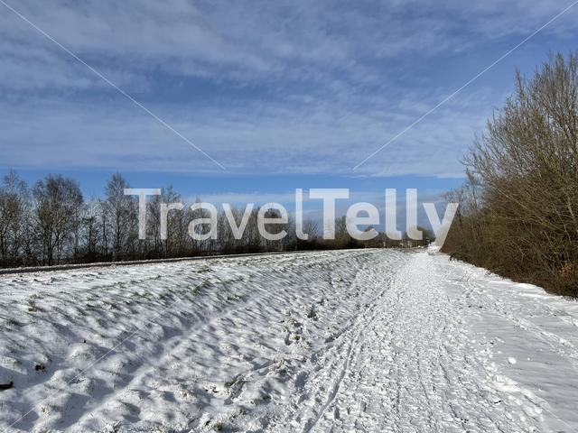 Snowy bicyle path at the bridge over the Prinses Margriet canal in Friesland The Netherlands