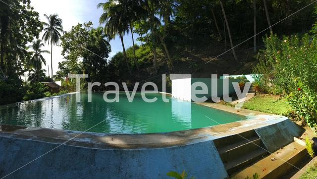 Panorama from a water pool at the country side of Anda Bohol the Philippines