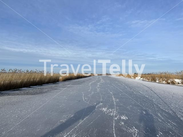 Frozen canal in Friesland The Netherlands