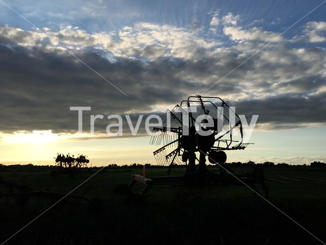 Farm equipment during sunset in Friesland The Netherlands