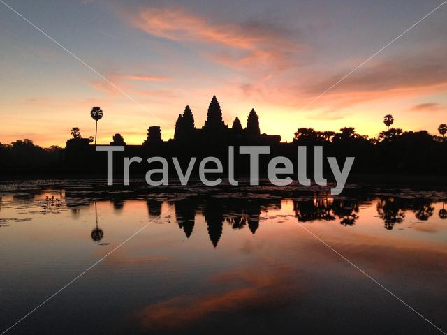 Angkor Wat was first a Hindu, later a Buddhist, temple complex in Cambodia and the largest religious monument in the world