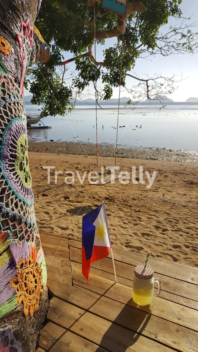 Pine apple juice, Philipinno flag and swing on beach
