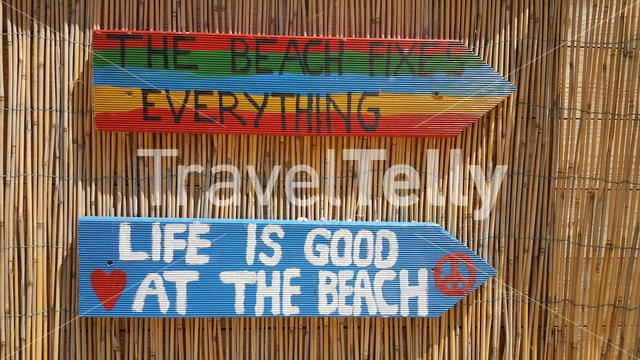 Life is good at the beach, sign on bamboo background
