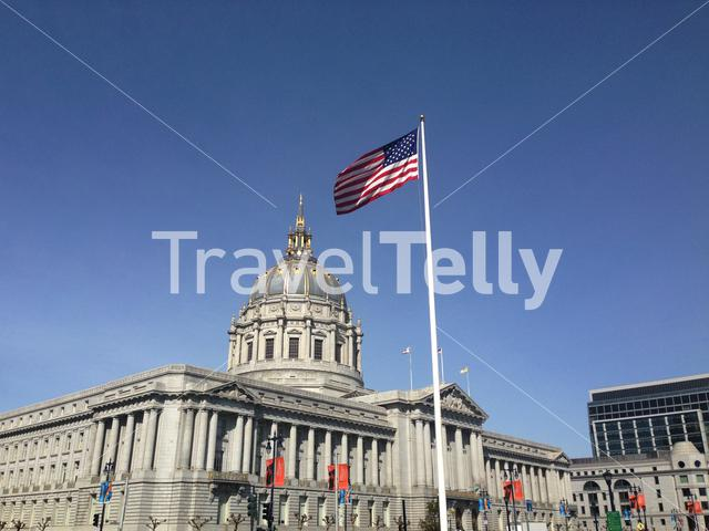 Flag of the United States together with the San Francisco City Hall is the seat of government for the City and County of San Francisco