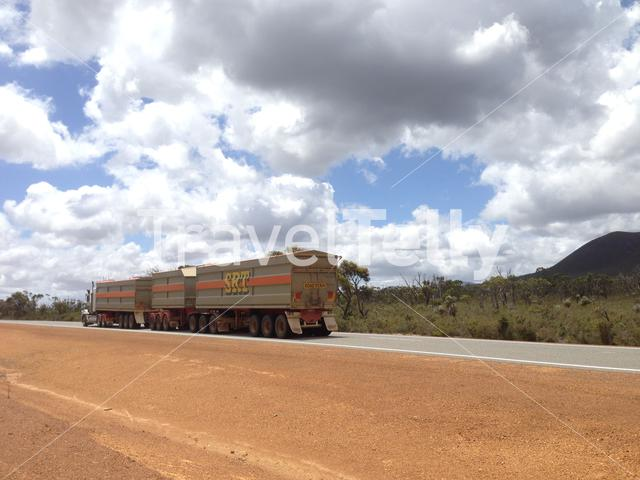 A road train passing by at the Stirling Range National Park in Western Australia