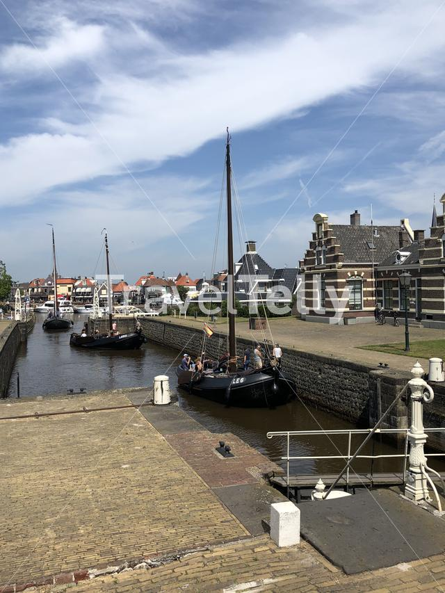 Sailboats entering the sea lock in Lemmer, Friesland The Netherlands