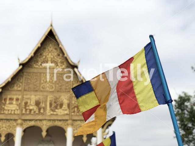 Buddhist flag at a buddhist Temple next to the Pha That Luang in Vientiane Laos