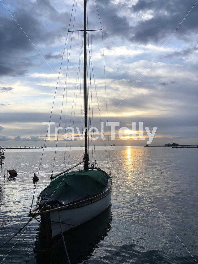 Sailboat during sunset at the waterfront in Trieste Italy