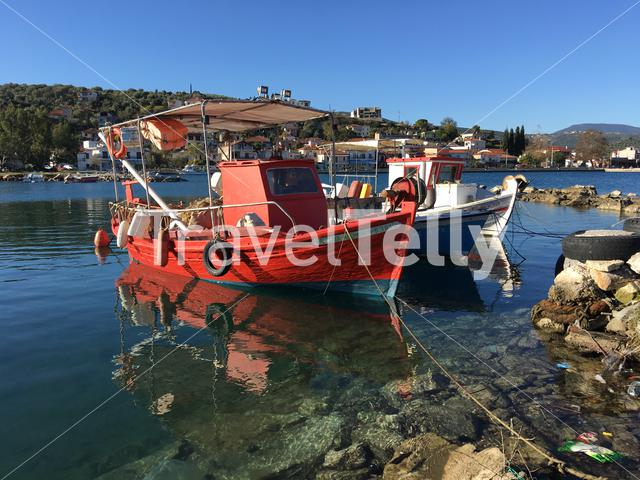 Fishing boats in the bay of Achilles Greece