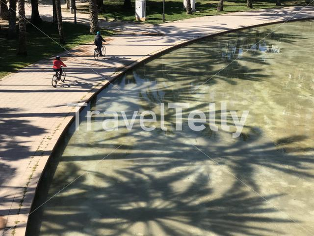 Cycling around the Puente del Mar at the Gardens of Turia in Valencia Spain