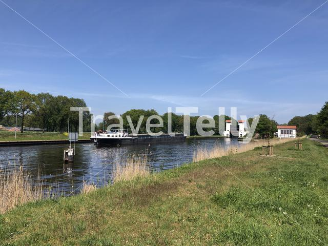 Cargo ship at a canal lock at the twente canal around Delden in The Netherlands