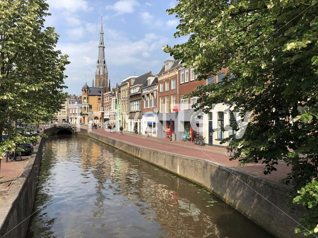 Canal with the Sint-Bonifatiuskerk church in the background in Leeuwarden, Friesland The Netherlands