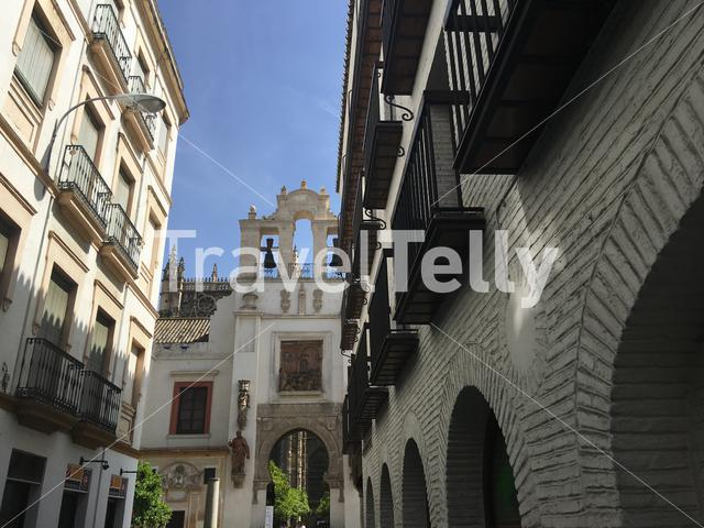 Door of Pardon and Patio de los Naranjos from the Calle Hernando Colon street in the old town of Seville Spain