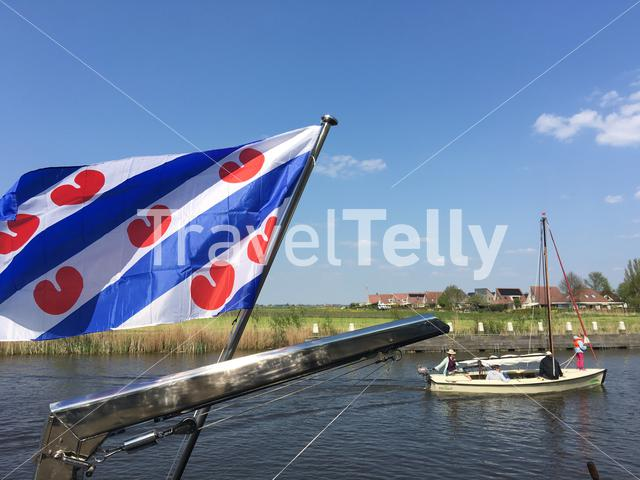 Frisian flag with a sailboat in Sloten, Friesland The Netherlands