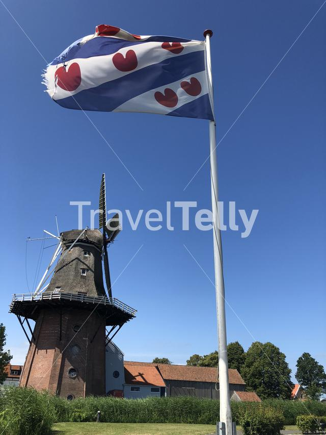 Frisian flag and the Windmill in Burdaard Friesland The Netherlands
