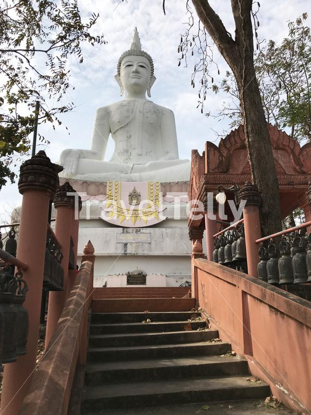 Stairs towards a big buddha statue in Phanom Sawai Forest Park Thailand