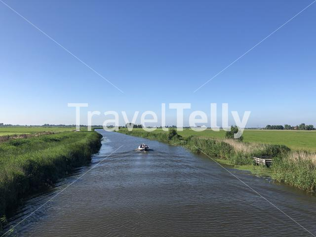 Boat on a canal in Friesland, The Netherlands