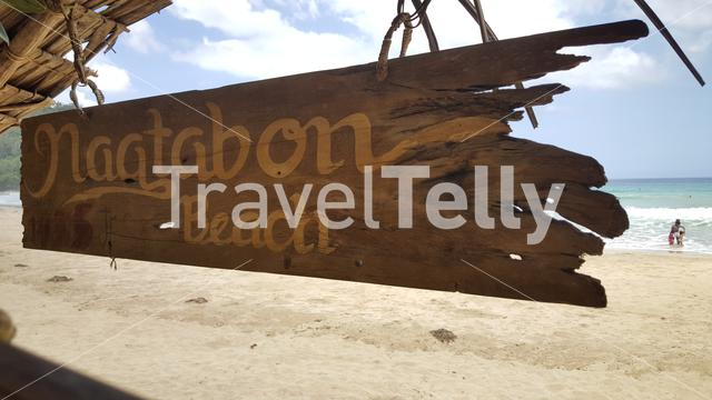 Nagtabon Beach sign on hut at tropical beach