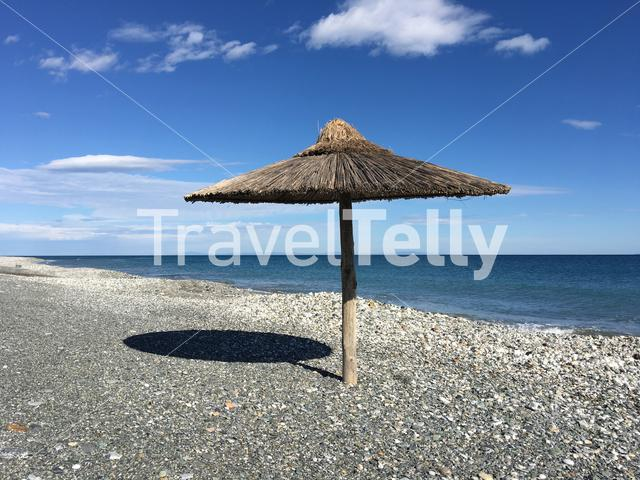 Parasol at velika beach in Greece