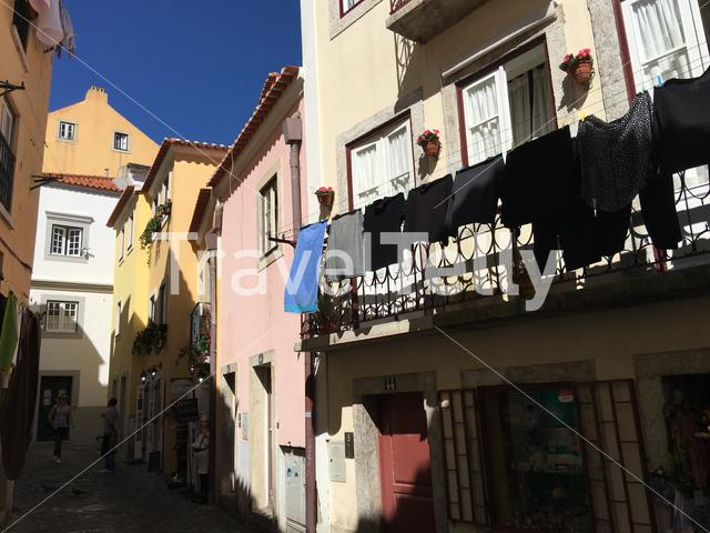 Laundry at a narrow street in the historical center of Lisbon Portugal
