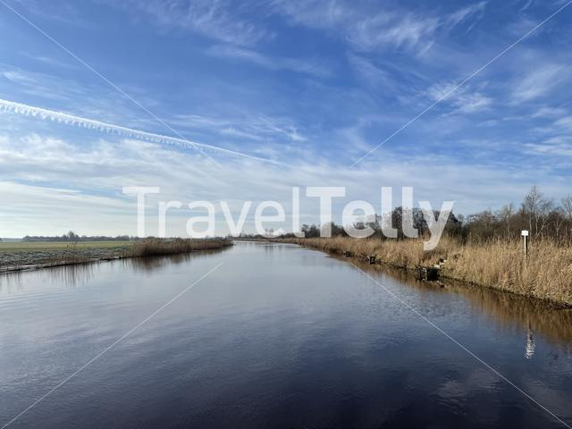 Canal around nature reserve De Deelen on a winter day in Friesland The Netherlands